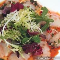 Sashimi salad with sea bass