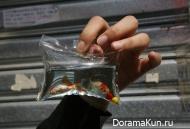 Китай. Живая рыбка в качестве брелка