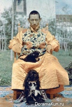 Buddhist Lama with his spaniels